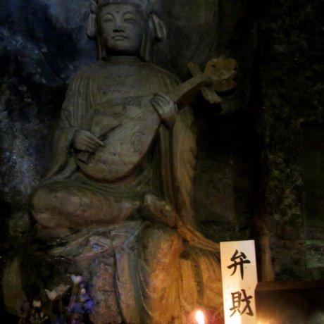 Statues in Benten-kutsu Cave
